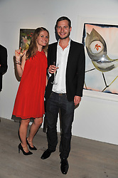 LOUISE DE PURY and ALBAN DE PURY children of Simon de Pury at Arts for Human Rights gala dinner in aid of The Bianca Jagger Human Rights Foundation in association with Swarovski held at Phillips de Pury & Company, Howick Place, London on 13th October 2011.