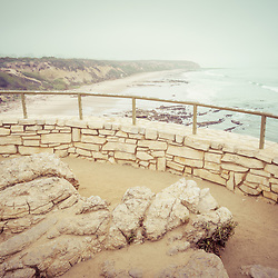Laguna Beach Crystal Cove State Park scenic overlook railing with the beach and Pacific Ocean in retro tone