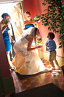 The bride greets a little guest as she enters the elegant Priory located on the Pittsburgh's North Shore.