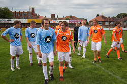 © Licensed to London News Pictures . 02/08/2015 . Droylsden Football Club , Manchester , UK . NICO MIRALLEGRO puts his hand on ELLIOTT TITTENSOR 's shoulder . Celebrity football match in aid of Once Upon a Smile and Debra , featuring teams of soap stars . Photo credit : Joel Goodman/LNP