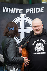 © Licensed to London News Pictures . 09/03/2013 . Swansea , UK . A man wearing a t shirt that reads CAMP AUSCHWITZ WORK BRINGS FREEDOM at the event . A white pride demonstration in Swansea to coincide with White Pride World Wide Day . Supporters of various far-right groups , including Blood and Honour and the National Front , attend . Photo credit : Joel Goodman/LNP