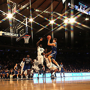 Patrik Auda, (right), Seton Hall, fouls James Bell, Villanova, as he drives to the basket during the Villanova Wildcats Vs Seton Hall Pirates basketball game during the Big East Conference Tournament at Madison Square Garden, New York, USA. 12th March 2014. Photo Tim Clayton