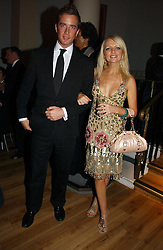 HANNAH SANDLING and OLIVER FELSTEAD at Andy & Patti Wong's annual Chinese New year Party, this year to celebrate the Year of The Pig, held at Madame Tussauds, Marylebone Road, London on 27th January 2007.<br />