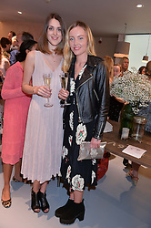 Left to right, CHLOE HERBERT and MADDY CLARK at a party to celebrate the re-launch of the Ghost Flagship store at 120 King's Road, London on 15th April 2015.
