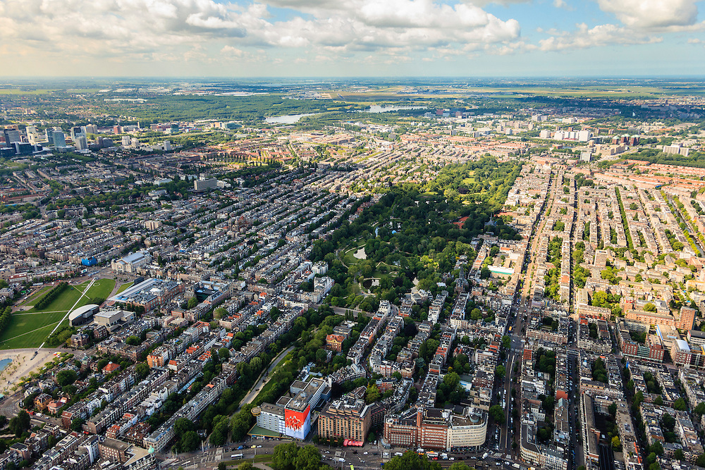 Nederland, Provincie, Amsterdam, 14-06-2012; Amsterdam Oud-West (r) met   Vondelpark en Overtoom, links Museumplein met Stedelijk Museum, Van Goghmuseum en Concertgebouw. Nieuwe Meer met Schiphol aan de verre horizon. Oranje Nike reklame op Barbizon gebouw..View on the south-east district of Amsterdam, the Museumplein (Bottom tight) with Concertgebouw, Stedelijk Museum and Van Goghmuseum and central in picture the Vondelpark. Airport Schiphol on the horizon. .luchtfoto (toeslag), aerial photo (additional fee required).foto/photo Siebe Swart