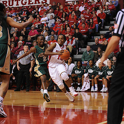 Jan 31, 2009; Piscataway, NJ, USA; Rutgers guard Epiphanny Prince (10) drives to the net past South Florida guard Janae Stokes (21) during the first half of South Florida's 59-56 victory over Rutgers in NCAA women's college basketball at the Louis Brown Athletic Center