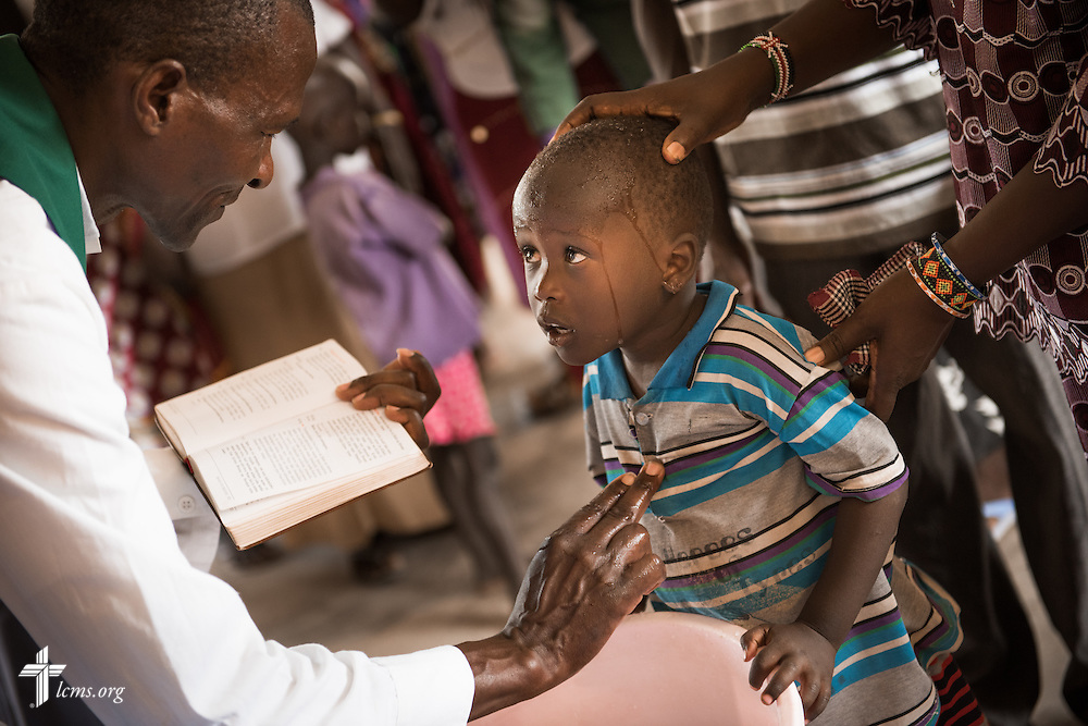 A child is baptized at the Lokichar Lutheran congregation of the Evangelical Lutheran Church in Kenya on Thursday, Oct. 15, 2015, in Lokichar, Kenya. LCMS Communications/Erik M. Lunsford