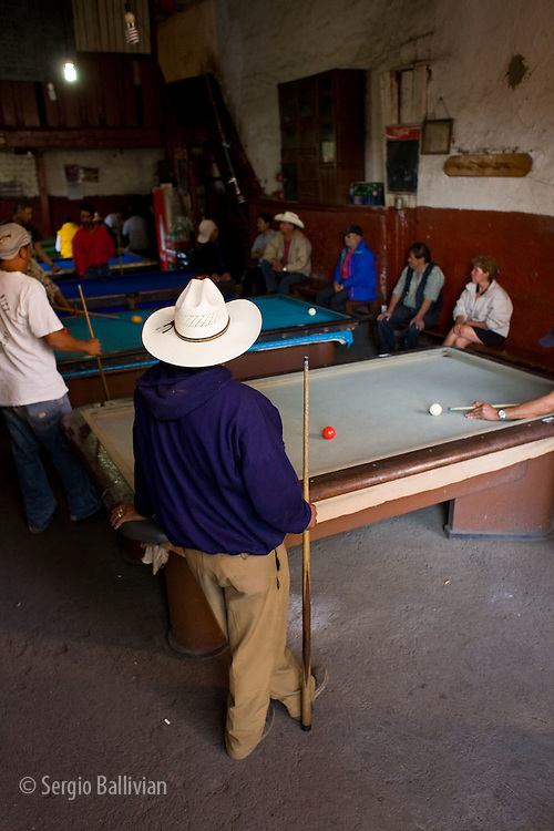 Mexican men playing biliards in a pool hall in Santa Clara, Michocan, Mexico.