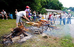 Spectators roasting sheep at Slovenian National Championships in Road cycling, 178 km, on June 28 2009, in Mirna Pec, Slovenia. (Photo by Vid Ponikvar / Sportida)