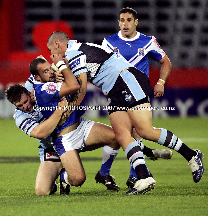 Auckland Lions' Corey Lawrie is tackled during the Premier Rugby League match between Auckland Lions and Sharks at Mt Smart Stadium, Auckland, New Zealand on Saturday 5 May 2007. The Sharks won the match 26 - 24. Photo: Hagen Hopkins/PHOTOSPORT<br /><br /><br /><br />050507
