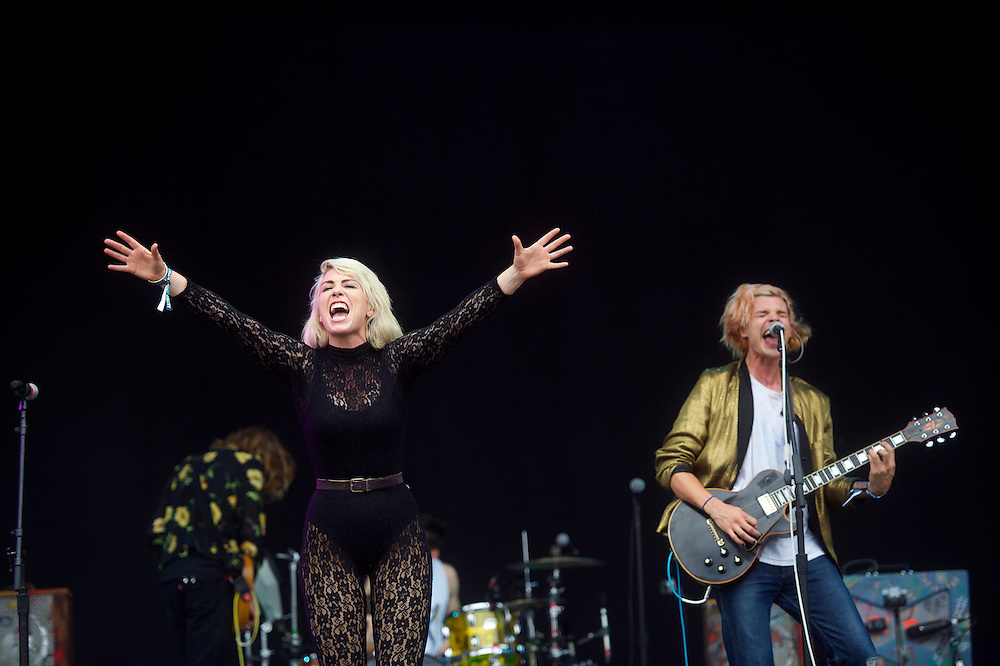 (L-R) Hannah Hooper and Christian Zucconi of the band Grouplove perform at the Firefly Music Festival in Dover, DE on June 21, 2014.  The four day festival is set at a 105 acre grounds at the Dover International Speedway and many well known bands perform.