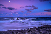Moon rising over the Atlantic Ocean at Sunset in Red Reef Park Boca Raton