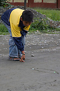Playing marbles on the Interoceanic Highway at Quincemil