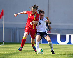 LLANELLI, WALES - Thursday, August 22, 2013: Wales' Alys Hinchcliffe in action against England's Melissa Lawley during the Group A match of the UEFA Women's Under-19 Championship Wales 2013 tournament at Parc y Scarlets. (Pic by David Rawcliffe/Propaganda)