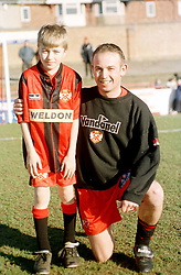 MASCOT ALEX  BLANCHARD WITH HERO KETTERING TOWN PHIL BROWN, Kettering Town v Scarborough Rockingham Road 12th February 2000