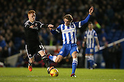 Brighton striker (on loan from Manchester United), James Wilson (21) is tackled by Brentford midfielder Ryan Woods during the Sky Bet Championship match between Brighton and Hove Albion and Brentford at the American Express Community Stadium, Brighton and Hove, England on 5 February 2016.