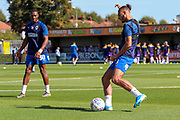 AFC Wimbledon defender Nesta Guinness-Walker (18) and AFC Wimbledon defender Paul Kalambayi (30) warming up during the EFL Sky Bet League 1 match between AFC Wimbledon and Shrewsbury Town at the Cherry Red Records Stadium, Kingston, England on 14 September 2019.