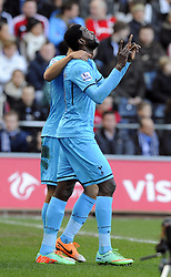 Tottenham Hotspur's Emmanuel Adebayor celebrates his goal - Photo mandatory by-line: Joe Meredith/JMP - Tel: Mobile: 07966 386802 19/01/2014 - SPORT - FOOTBALL - Liberty Stadium - Swansea - Swansea City v Tottenham Hotspur - Barclays Premier League