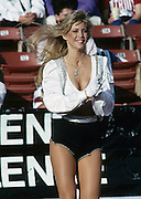 A Los Angeles Raiders cheerleader performs during the NFL football game between the New England Patriots and the Oakland Raiders on November 26, 1989  in Los Angeles, California. The Raiders won the game 24-21. ©Paul Anthony Spinelli