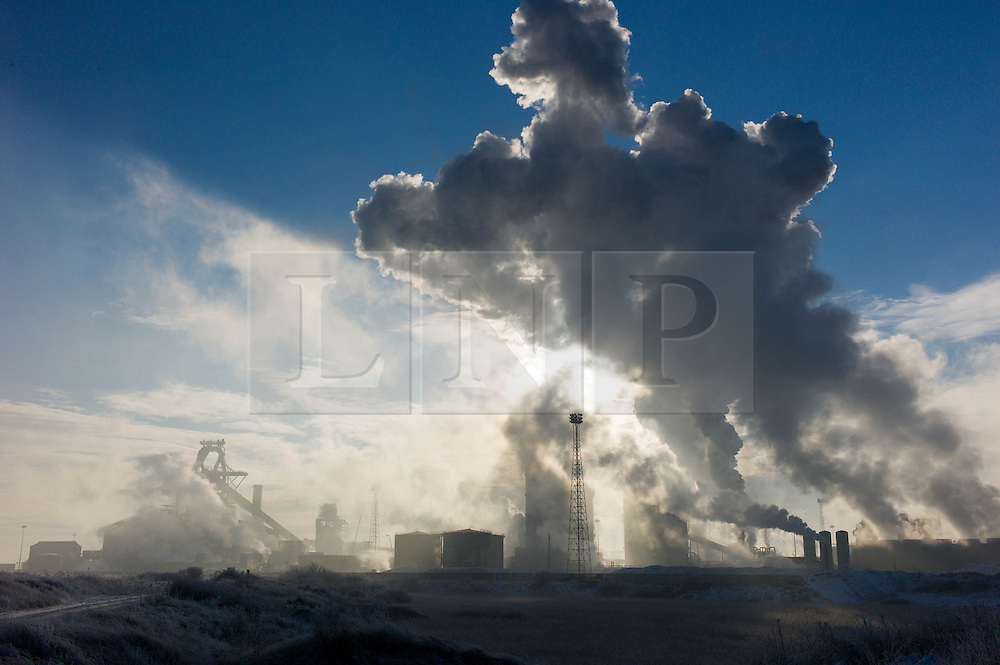 © Licensed to London News Pictures. 17/01/2013..South Gare, Teesside, England..An ice cold winter fog blankets an area known as South Gare on Teesside as the smoke stacks spill into the morning light...Photo credit : Ian Forsyth/LNP