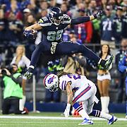 Seattle Seahawks tight end Jimmy Graham (88) huddles over Buffalo Bills cornerback Stephon Gilmore (24) during an NFL regular season game on Monday, Nov. 7, 2016 in Seattle. (Ben Liebenberg via AP)