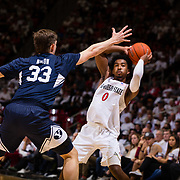 22 December 2018: San Diego State Aztecs guard Devin Watson (0) looks to pass the ball while being defended by Brigham Young Cougars forward Dalton Nixon (33) in the second half. The Aztecs beat the Cougars 90-81 Satruday afternoon at Viejas Arena.