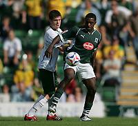 Photo: Lee Earle.<br /> Plymouth Argyle v Norwich City. Coca Cola Championship. 23/09/2006. Norwich's Patrick Boyle (L) battles with Sylvan Ebanks-Blake.