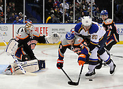 New York Islanders' Calvin de Haan (44) and St. Louis Blues' Alexander Steen battle for the puck as Islanders goalie Kevin Poulin (60) and Thomas Hickey (14) defend from behind during an NHL hockey game on Saturday, Jan. 25, 2014, in Uniondale, N.Y. (AP Photo/Kathy Kmonicek)