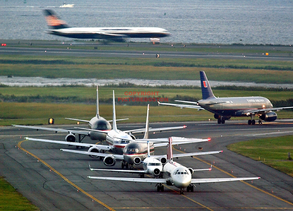 "Various airliners flying in and around Boston's Logan International Airport. Very long lens. NO trickery or photoshop. All photos are ""real time"" with no trickery or multiple exposure."