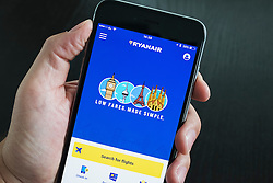 Ryanair low cost airline flight booking app on iPhone 6 Plus smart phone