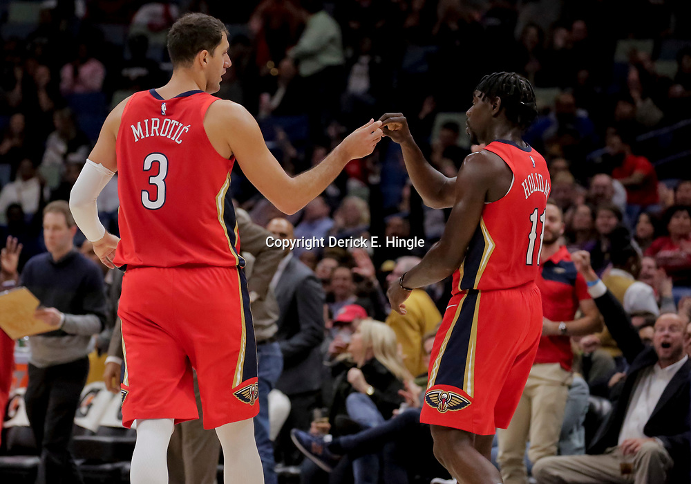 Nov 28, 2018; New Orleans, LA, USA; New Orleans Pelicans forward Nikola Mirotic (3) and guard Jrue Holiday (11) against the Washington Wizards during the second half at the Smoothie King Center. Mandatory Credit: Derick E. Hingle-USA TODAY Sports