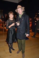 JOANNA WOOD and TIM BEDDOW at a party to celebrate the publication of Interiors For Living by Joanna Wood held at Christie's. 8 King Street, St.James's, London on 2nd March 2015.