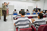 "06 NOVEMBER 2006 - PHOENIX, AZ:  GRANT SOLOMON, a Detention Officer in the Maricopa County Jail, teaches an English jail for Spanish speaking prisoners in the jail. Maricopa County Sheriff Joe Arpaio is offering intensive two week English classes in the Maricopa County Jails so county prisoners can communicate with Detention Officers. The classes teach ""jail English"" so inmates can report medical problems, request their lawyers, request bedding etc. There are more than 1,000 illegal immigrants in the county jail system. In 2011, the US Department of Justice issued a report highly critical of the Maricopa County Sheriff's Department and the jails. The DOJ said the Sheriff's Dept. engages in widespread discrimination against Latinos during traffic stops and immigration enforcement, violates the rights of Spanish speaking prisoners in the jails and retaliates against the Sheriff's political opponents.      PHOTO BY JACK KURTZ"