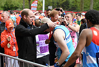 Prince William, Duke of Cambridge and Prince Harry give out medals to the finishers of the 2017 Virgin Money London Marathon.<br /> The Virgin Money London Marathon, 23rd April 2017.<br /> <br /> Photo: Karwai Tang for Virgin Money London Marathon<br /> <br /> For further information: media@londonmarathonevents.co.uk