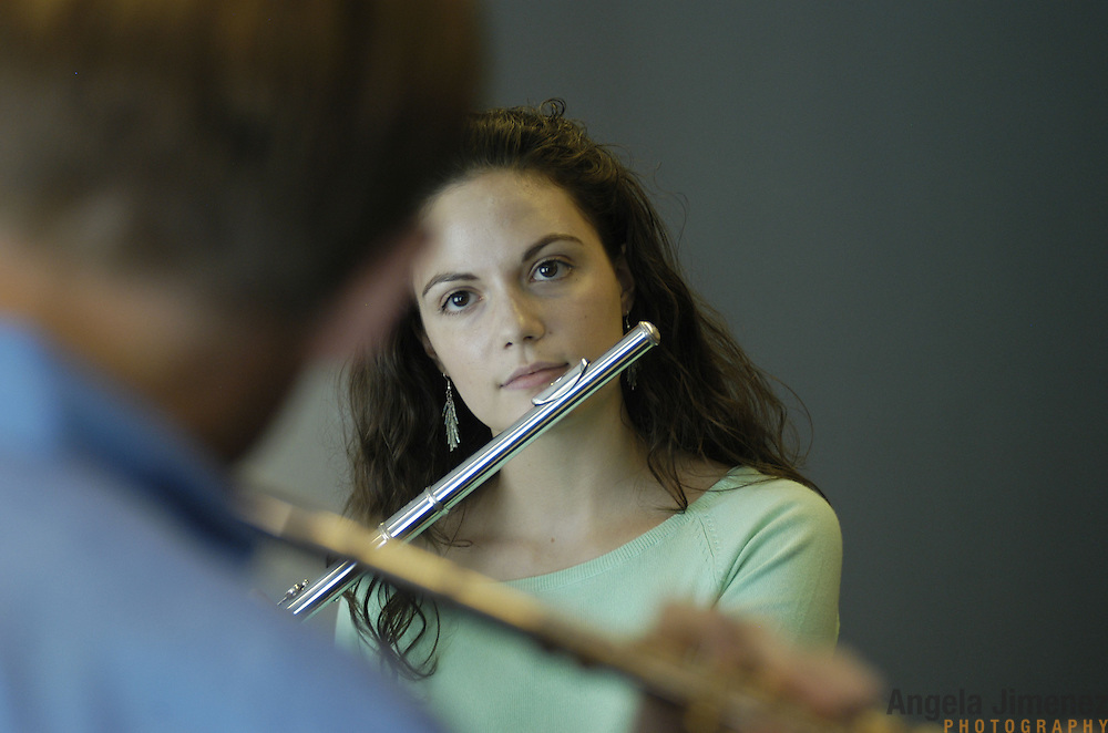 Megan Emigh, 17, right, of Haddonfield, New Jersey, takes her weekly private flute lesson with Dr. Bradley Garner, left, in the Pre-College Division program at The Juilliard School, located at West 65th Street and Broadway in New York City, on Saturday, September 24, 2005. Students audition for spots in the prestigious program, in which they can study until they graduate from high school.