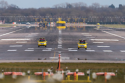 © Licensed to London News Pictures. 29/02/2016. Gatwick, UK. Two vehicles inspect the main runway at Gatwick Airport in West Sussex, after it was cleaned up. The main runway is currently closed due to a spillage and due to reopen soon. Photo credit: Peter Macdiarmid/LNP