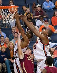 Virginia guard Sean Singletary (44) shoots over Elon guard Chris Long (13).  The Virginia Cavaliers men's basketball team defeated the Elon Phoenix 91-61  at the John Paul Jones Arena in Charlottesville, VA on December 22, 2007.