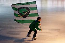Young hockey player with flag during ice-hockey match between HDD Tilia Olimpija and EHC Liwest Black Wings Linz in 51st Round of EBEL league, on Februar 5, 2012 at Hala Tivoli, Ljubljana, Slovenia. (Photo By Matic Klansek Velej / Sportida)
