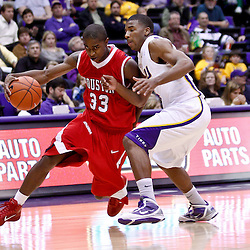 November 30, 2010; Baton Rouge, LA, USA;  Houston Cougars guard Trumaine Johnson (33) drives past LSU Tigers guard Chris Bass (4) during the second half at the Pete Maravich Assembly Center. LSU defeated Houston 73-57. Mandatory Credit: Derick E. Hingle