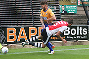 Aaron Martin of Exeter City (5) is fouled during the EFL Sky Bet League 2 match between Mansfield Town and Exeter City at the One Call Stadium, Mansfield, England on 15 September 2018.