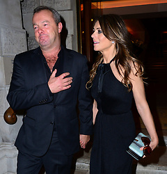 David Yarrow with Elizabeth Hurley attends Christie's Conservation Lectures 2014 as British photographer Yarrow takes part in Christie's latest Conservation Lectures event, held in aid of the Tusk Trust, and discusses his latest book Encounter, which was released in 2013, at Christie's, London, United Kingdom. Wednesday, 30th April 2014. Picture by Nils Jorgensen / i-Images