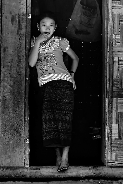 A Hmong girl in a village close to the Gibbon Experience where the villages have benefitted tremendously with projects payed for by the Gibbon Experience in Bokeo, Laos.