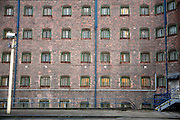 The cell windows of one of the wings at Liverpool prison watched over by a security camera in the prisons courtyard..HMP Liverpool in Merseyside was built in 1855 and is one of the largest prisons in Western Europe. It has a capacity of 1393 prisoners who are spread over 8 wings.