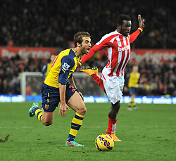 Arsenal's Mathieu Flamini is fouled by Stoke's Mame Biram Diouf for a penalty  - Photo mandatory by-line: Dougie Allward/JMP - Mobile: 07966 386802 - 06/12/2014 - SPORT - Football - Stoke - Britannia Stadium - Stoke City v Arsenal - Barclays Premie League
