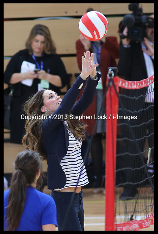 The Duchess of Cambridge plays volleyball at a SportsAid Athlete Workshop at the Copper Box, in the Queen Elizabeth Olympic Park in London,  Friday, 18th October 2013. Picture by Stephen Lock / i-Images