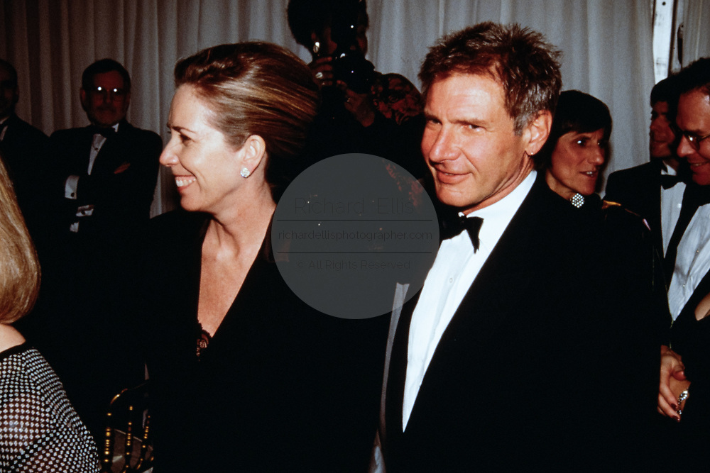 Actor Harrison Ford and his wife Melissa Mathison during the State Dinner honoring British Prime Minister Tony Blair at the White House February 5, 1998 in Washington, DC.