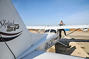 Pilot perform a preflight check on a cessna skyhawk