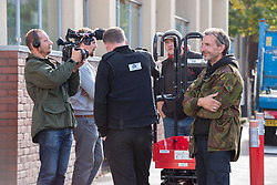 © Licensed to London News Pictures. 24/09/2019. Bristol, UK. Picture of Channel 5 filming as supporters of resident to be evicted try to stop a lift being brought to the site. Bailiffs from EAS Enforcement with the landlord and agents and police present, and being filmed by Channel 5 for television, attempt an eviction at 26 Picton Lane, Montpelier. A resident (in flat cap) can be seen on the roof of a van and building as bailiffs use a scissor lift to try and access the roof, after supporters of the resident try and block the lift from being brought to the site. Photo credit: Simon Chapman/LNP.