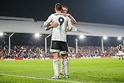 Fulham forward Aleksandar Mitrović (9) celebrates with Fulham defender Alfie Mawson (5) after scoring a goal (3-1) during the EFL Sky Bet Championship match between Fulham and Luton Town at Craven Cottage, London, England on 23 October 2019.