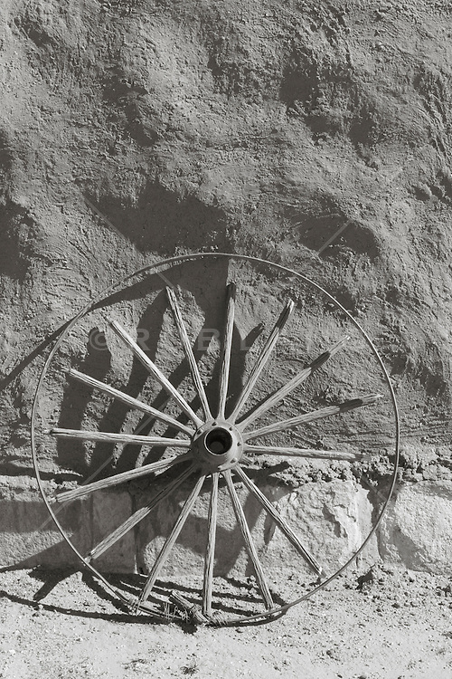 Adobe Structure and a wooden wheel at Fort Union National Monument in New Mexico
